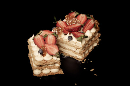 Puff homemade cake with cream and berries. Toned.