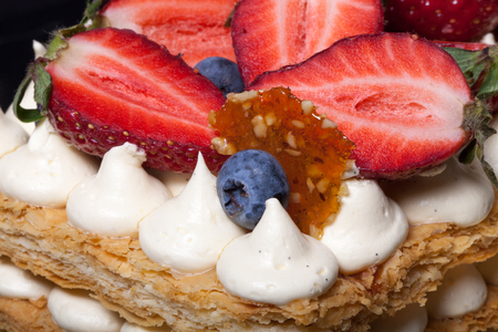 Puff homemade cake with cream and berries. Selective Focus. Shallow depth of field.