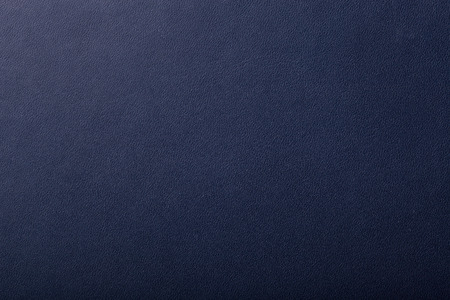 dark blue: Surface of leatherette for textured background.