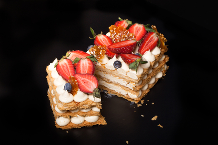 mille: Puff homemade cake with cream and berries. Toned.