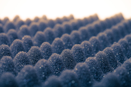 polyurethane: The texture of the sponge with embossed surface for background. Selective focus. Shallow depth of field. Toned. Stock Photo