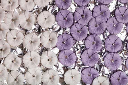 fondant fancy: Many sugar mastic flowers for background.
