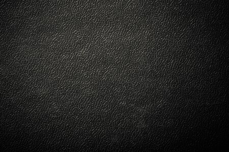 textured: Surface of leatherette for textured background. Toned.
