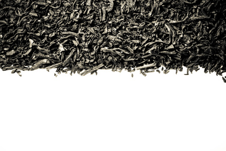 pekoe: Dry black tea leaves as texture for background. Toned.