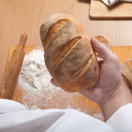 milling rolling: The process of making home bread by male hands.