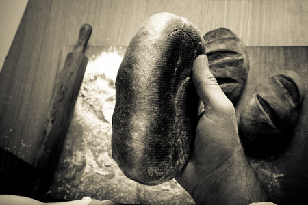 The process of making home bread by male hands. Toned.