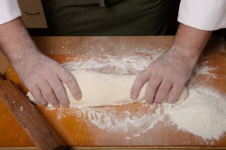 The process of making home bread by male hands.