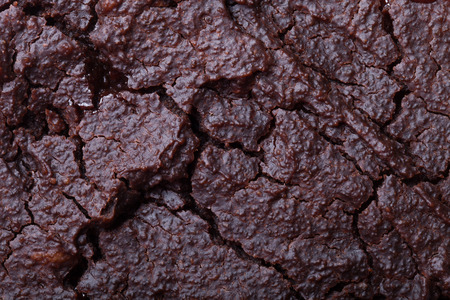 full of holes: The surface of fresh chocolate biscuit for background. Stock Photo