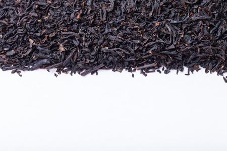 pekoe: Dry black tea leaves as texture for background.