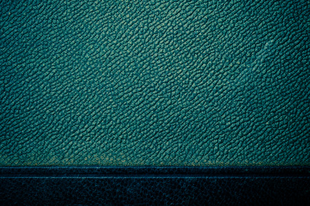 leatherette: Old surface of leatherette for textured background. Toned.