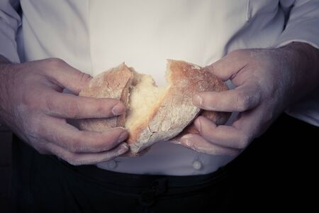Fresh home bread in males hands. Toned.