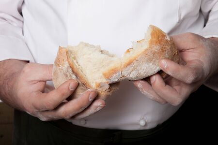Fresh home bread in males hands.