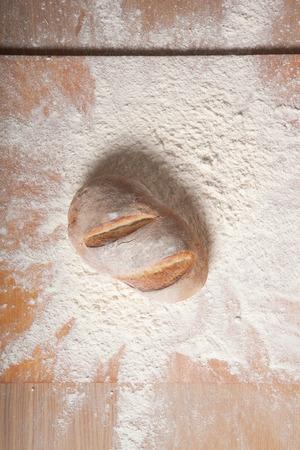 Fresh home bread fell in a heap of flour.