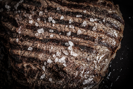 meat grill: Large piece of fresh beef meat prepared on a grill pan. Toned. Stock Photo