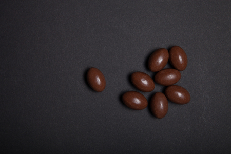 chocolate eggs: Small chocolate eggs on the black table.