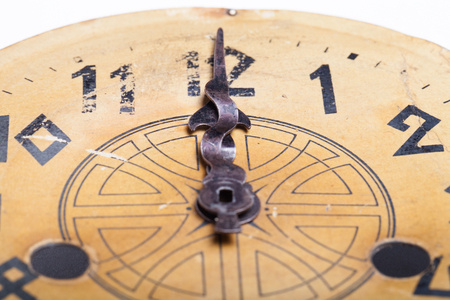 arabic numeral: Clock face of the old clock. Selective focus.