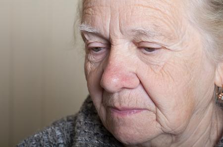 grayness: Portrait of an elderly woman. Closeup view.