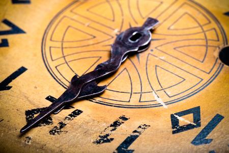 numeros romanos: Clock face of the old clock. Selective focus. Shallow depth of field. Toned. Foto de archivo
