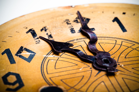 hands  hour: Clock face of the old clock. Selective focus. Shallow depth of field. Toned. Stock Photo