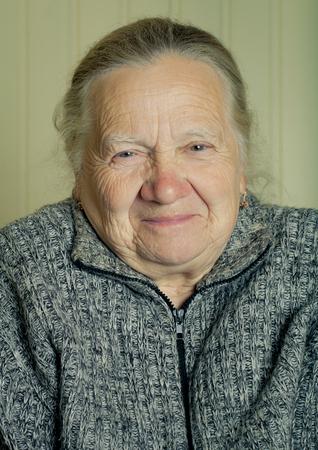 grayness: Portrait of an elderly woman. Toned.