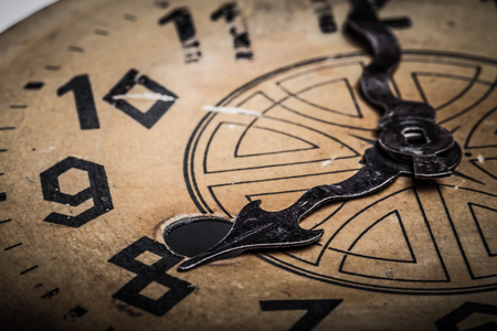 Clock face of the old clock. Selective focus. Shallow depth of field. Toned. Stock Photo