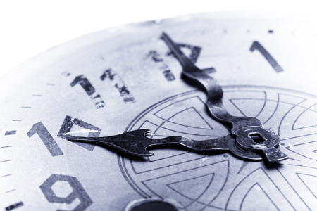 arabic numeral: Clock face of the old clock. Selective focus. Shallow depth of field. Toned. Stock Photo