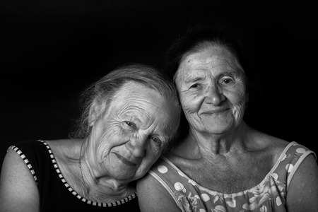 grayness: Portrait of two elderly sisters Smile. Toned.