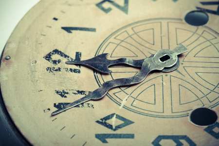 ancient pass: Clock face of the old clock. Selective focus. Shallow depth of field. Toned. Stock Photo