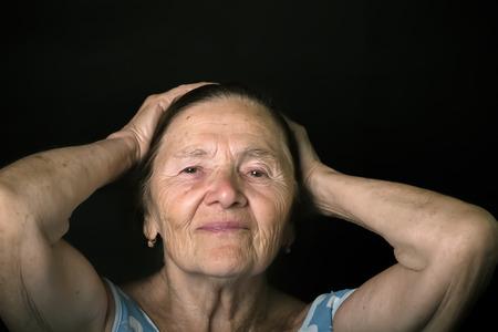grayness: Portrait of elderly woman. Toned.