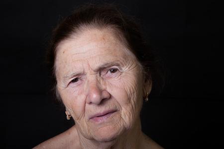 grayness: Portrait of elderly woman. Stock Photo