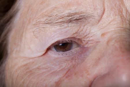 grayness: Portrait of elderly woman. Closeup.