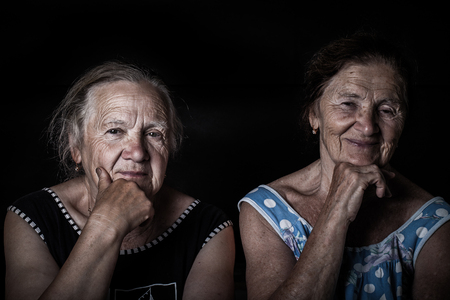 Portrait of two elderly sisters. Toned.
