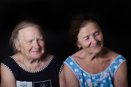 Portrait of two elderly sisters Smile.