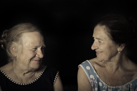 Portrait of two elderly sisters Smile. Toned.