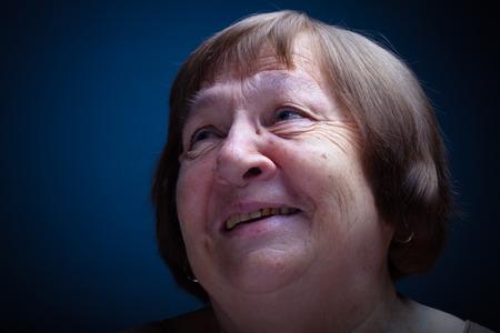 grayness: Portrait of elderly woman. Smile. Toned.