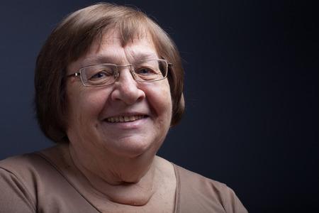 Portrait of elderly woman. Smile.