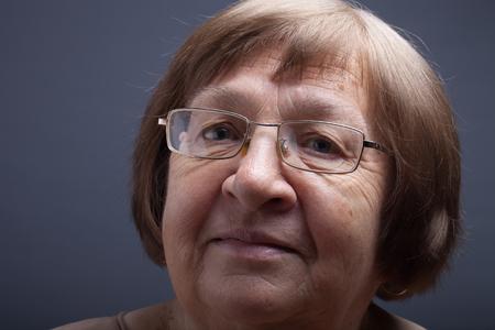 grayness: Portrait of elderly woman Smile. Stock Photo