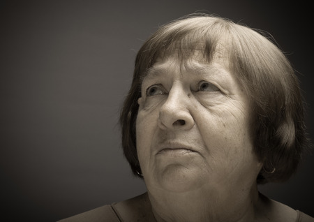 grayness: Portrait of elderly woman. Grievance. Toned.