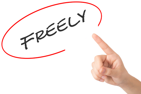 freely: Hand of a young girl points to a freely word.