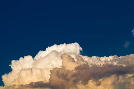 nebulosity: Blue sky with white clouds like a mountain. Toned. Stock Photo