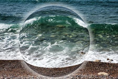 Wave on the pebble coast of sea.