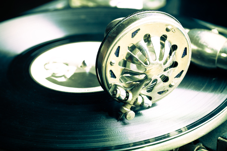 antiques: The old gramophone. Close up view. Selective focus. Shallow depth of field. Toned.