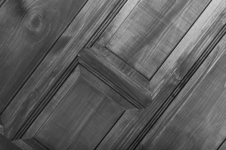 fragment: Fragment of new painted wooden door. Toned. Stock Photo