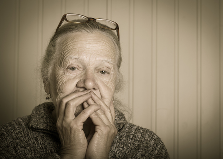 grayness: Portrait of elderly woman in glasses. Toned.