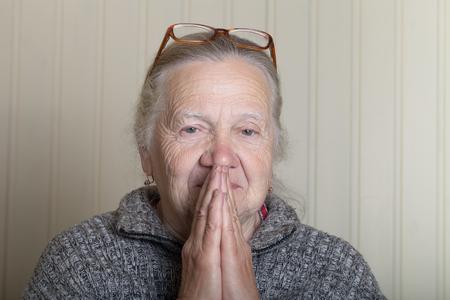 grayness: Portrait of elderly woman in glasses.