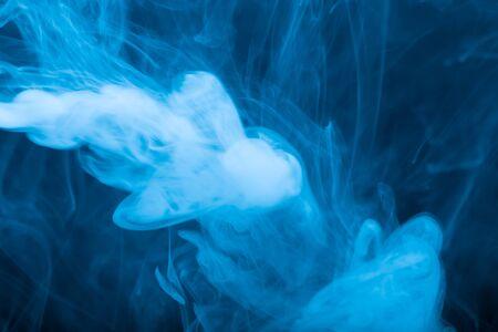 smoky black: Cloud of smoke on black background. Selective focus. Toned.