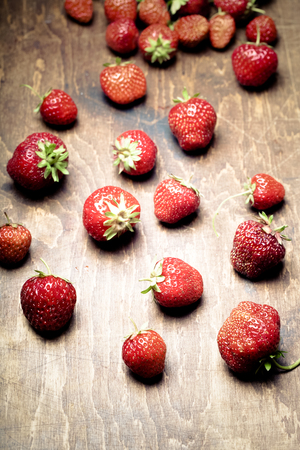 field depth: Lots of fresh bright red strawberries. Selective focus. Shallow depth of field. Toned.