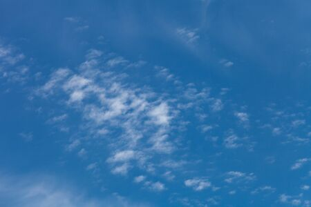nebulosity: White clouds on a blue sky. Selective focus. Stock Photo