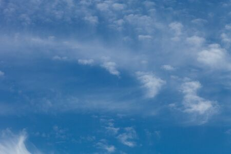 White clouds on a blue sky. Selective focus. Stock Photo