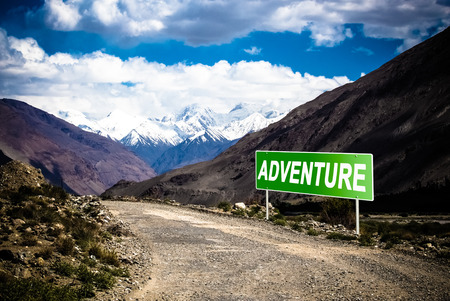 Pointer on mountain road in Tajikistan. Pamir highway. Toned.